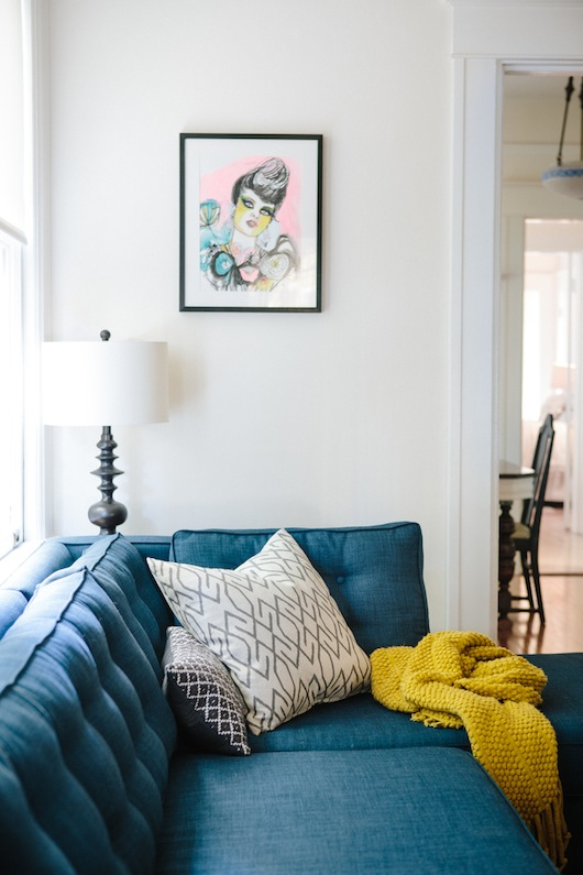 Blue couch. Home of Kate Davison + Jesse Hayes via This is Brick + Mortar. Photo by Colin Price.
